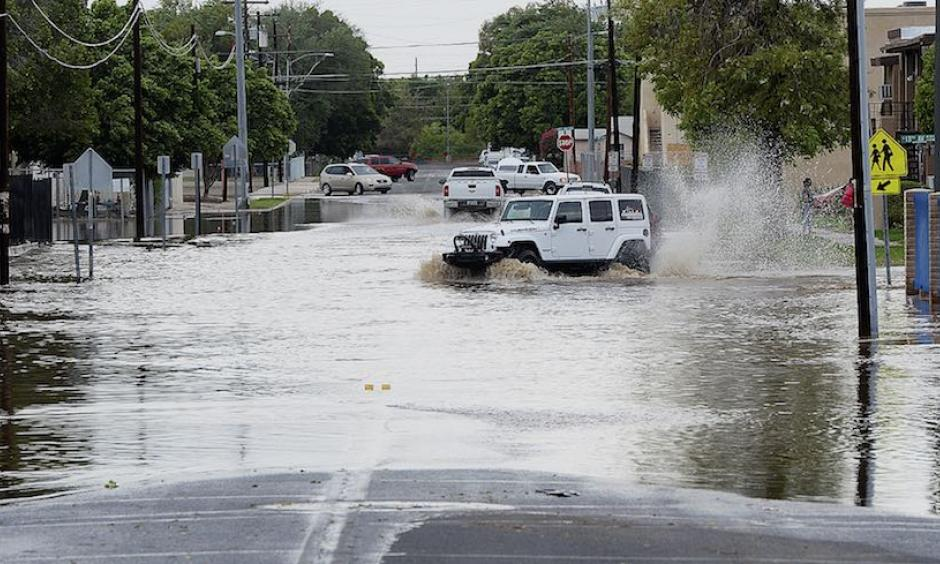 """Vehicles navigate a flooded 5th Street in Yuma, Ariz., after an early-afternoon rainstorm on Sunday, Sept. 30, 2018. Yuma picked up 0.65"""" of rain on Sunday and 0.26"""" on Monday. The storm total of 0.91"""" compares to Yuma's annual average (1981-2010) of just 3.56"""". One station in northern Yuma recorded 2.77"""" over the past two days, amounting to about three-quarters of the average annual rainfall. Photo: Randy Hoeft, Yuma Sun via AP"""