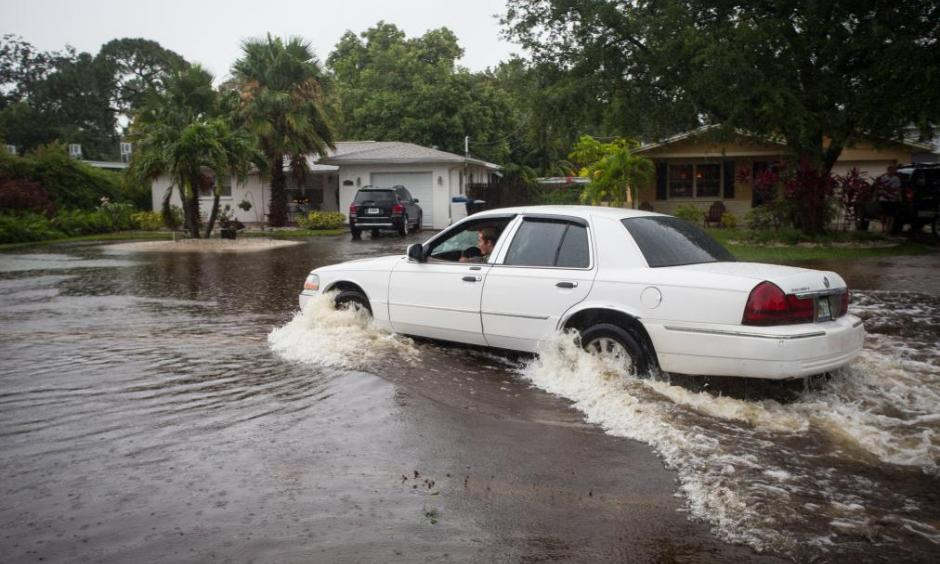 A motorist drives down a flooded street in St. Petersburg, Fla., after Tropical Storm Colin dumped heavy rains over the Tampa Bay area on June 7, 2016. Photo: Lauren Elliot, AP