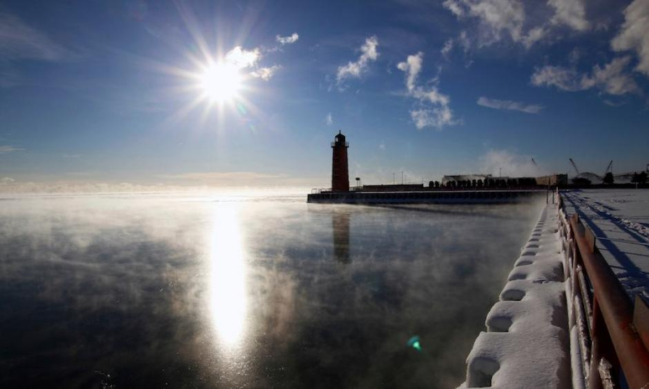 Steam rises from Lake Michigan on Friday morning, Jan. 25, 2019, in Milwaukee, Wisconsin. A cold blast sent temperatures plunging and prompted officials to close dozens of schools Friday. Even colder conditions are expected next week. Photo: Carrie Antlfinger, AP
