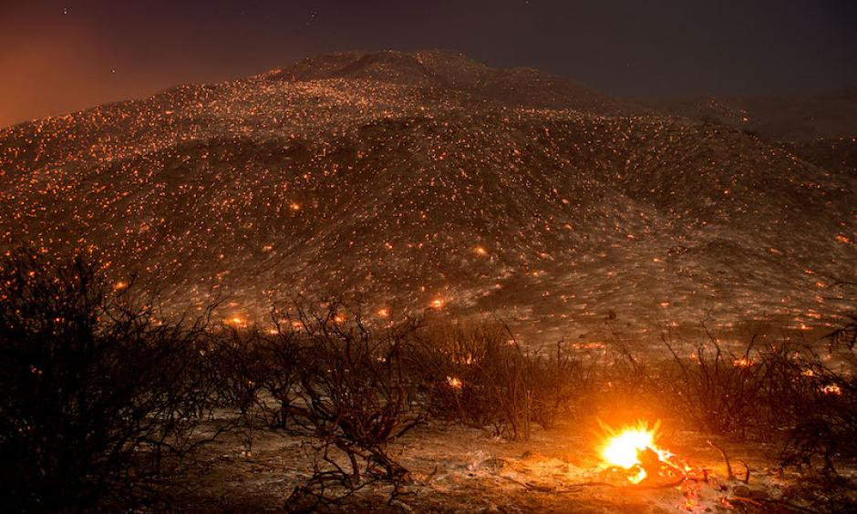 Embers from the Blue Cut fire smolder along Lytle Creek Road near Keenbrook, CA, on Wednesday, August 17, 2016. Photo: Noah Berger, AP