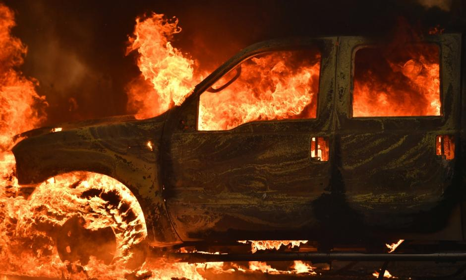 A truck burns on Main Street in the town of Lower Lake, Calif. on Sunday. Photo: Josh Edelson, AP