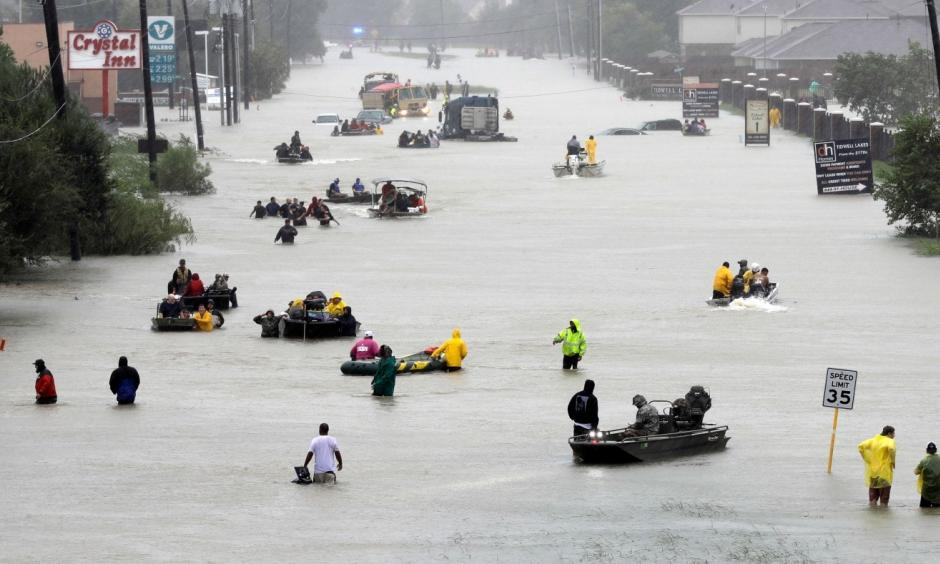 Rescue boats fill a flooded street as victims are evacuated from Harvey's rising waters Aug. 28 in Houston. Photo: David J. Phillip, AP