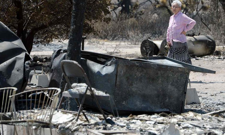 Ki Jo So returns to her home and property burned by the Blue Cut Fire off of the 138 for the first time Monday August 22, 2016. So, who has lived on the property for 13 years with her family, had no insurance. Photo: Will Lester