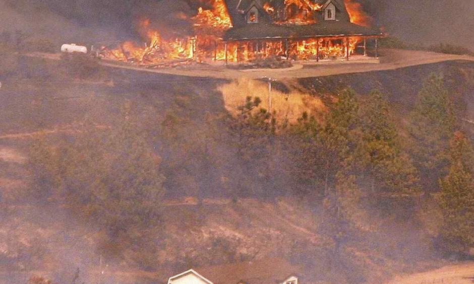 A structure burns near Loma Prieta Road and Loma Chiquita Road in Santa Clara County on Monday. Photo: Vern Fisher - Monterey Herald