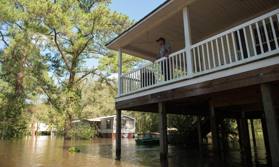 Mitch Townsend stands on the porch of his home as floodwaters from Little Swift Creek rise in Vanceboro on Oct. 10, 2016. Hurricane Matthew xxaused some major flooding in wetern parts of Craven County and throughout the eastern part of the state, flooding that even surprised forecasters, according to a report on the storm. Photo: Sun Journal File