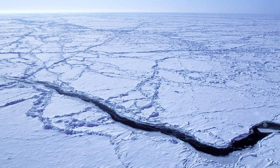 An ice lead in the Arctic Ocean is captured from the NSF/NCAR C-130 aircraft as it flies roughly 30 meters (100 feet) above the ocean during a field project studying low-level ozone formation. Photo: James Hannigan, UCAR