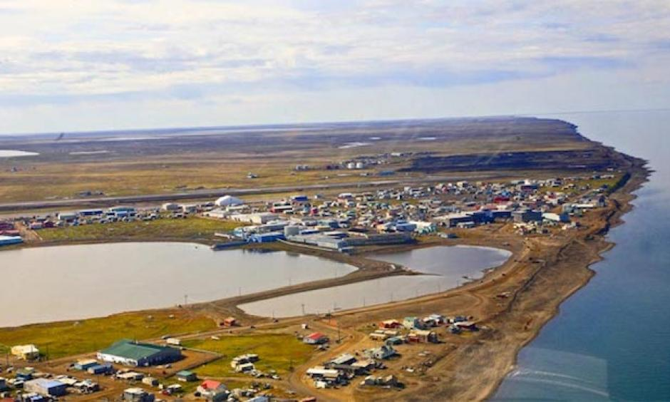 """An aerial image of Barrow (Utqiagvik), Alaska. Barrow is located at a latitude of 71°17'26"""", about 300 miles north of the Arctic Circle. Every month since December 2015 the temperature has averaged above normal here and, in addition, no daily record low has been set for almost 10 years now. Photo: Wikipedia"""