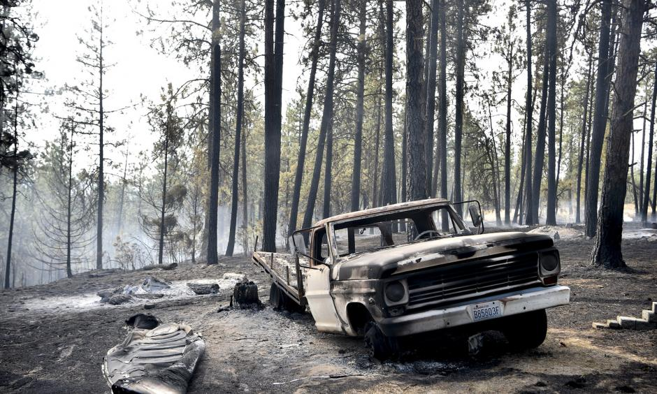 A charred truck is seen near the home of Julie Thayer and her husband, Art, on South Yale Road near Valleyford, Spokane County, on Monday. The Thayers had been hiking over the weekend and returned home. Photo: Tyler Tjomsland, The Spokesman-Review