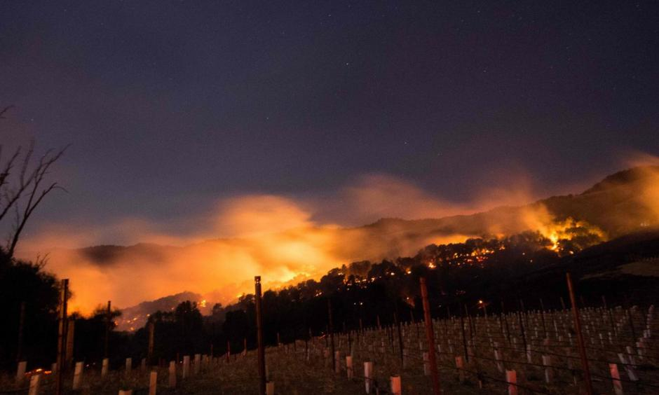 Fire glows on a hillside in Napa. Photo: Josh Edelson, AFP/Getty Images