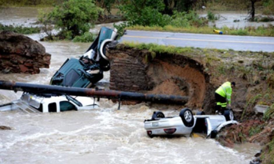 Bridge washout and its results at Highway 287 and Dillon Rd. in Lafayette just east of Boulder. Photo: Cliff Grassmick, Boulder County News