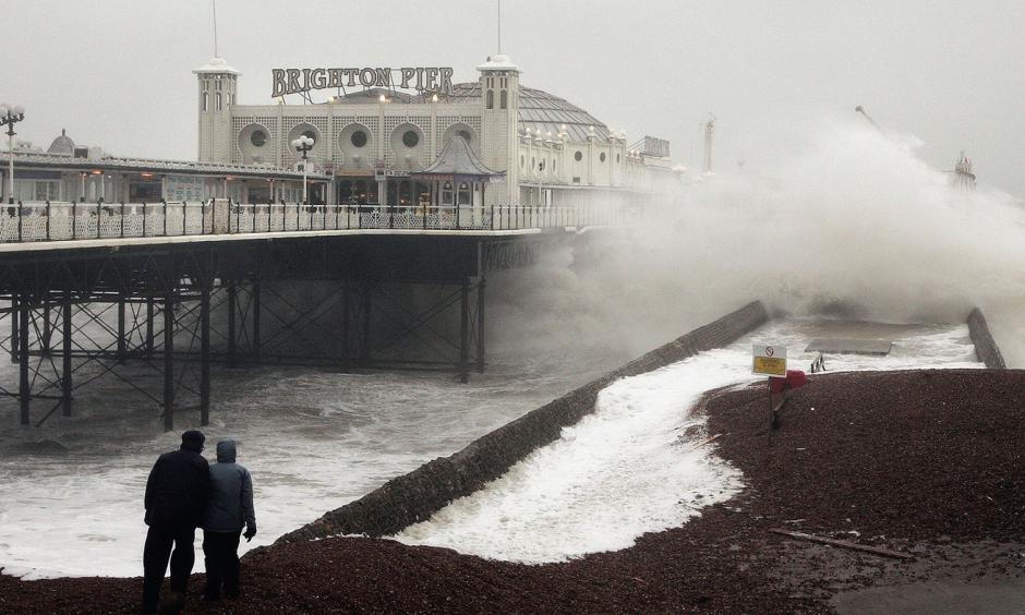 Waves crash onto the beach near Brighton Pier in England, in January 2007. Gale force winds and heavy rain brought disruption to large parts of the country. Severe weather events like this one may be linked to more frequent fluctuations in the polar jet stream, according to a new study. Photo: Peter Macdiarmid, Getty Images
