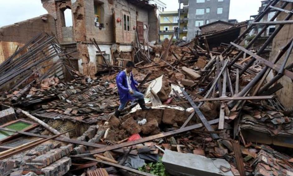 In this July 9, 2016 photo, a villager walks around a destroyed house, after torrential rainfall brought by typhoon Nepartak, in Lingcuo village of Xindu Township in Putian, southeast China's Fujian Province. Typhoon Nepartak weakened to a strong tropical storm Saturday as it lashed China's east coast, bringing powerful winds and heavy rains that toppled houses and inundated roads. Photo: Zhang Guojun/Xinhua News Agency via AP