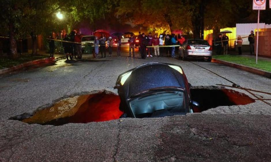 Sinkhole swallows two cars in Studio City. Photo: Los Angeles Times