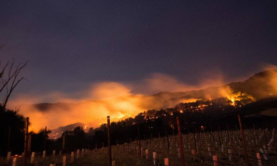Fires spread by the Diablo winds and fueled by dry grass and brush spread through California's Napa and Sonoma regions in early October 2017. Scientists say climate change is loading the dice for wildfires. Photo: Josh Edelson, AFP/Getty Images