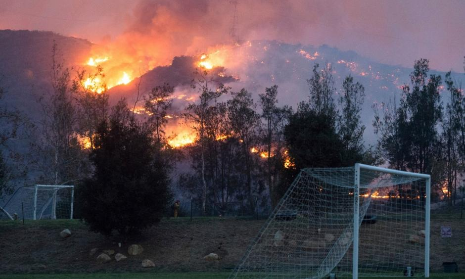 Flames from a wildfire consume the mountainside near the Cate School campus in Carpinteria, Calif., on Sunday. Photo: Kenneth Song, Santa Barbara News-Press via AP