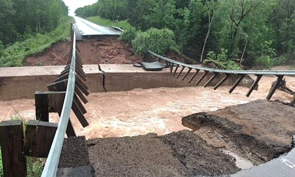 Flash flooding washed out U.S. Highway 2 at North Fish Creek, about 10 miles west of Ashland, Wis., on Sunday. Credit: Wisconsin Department of Transportation