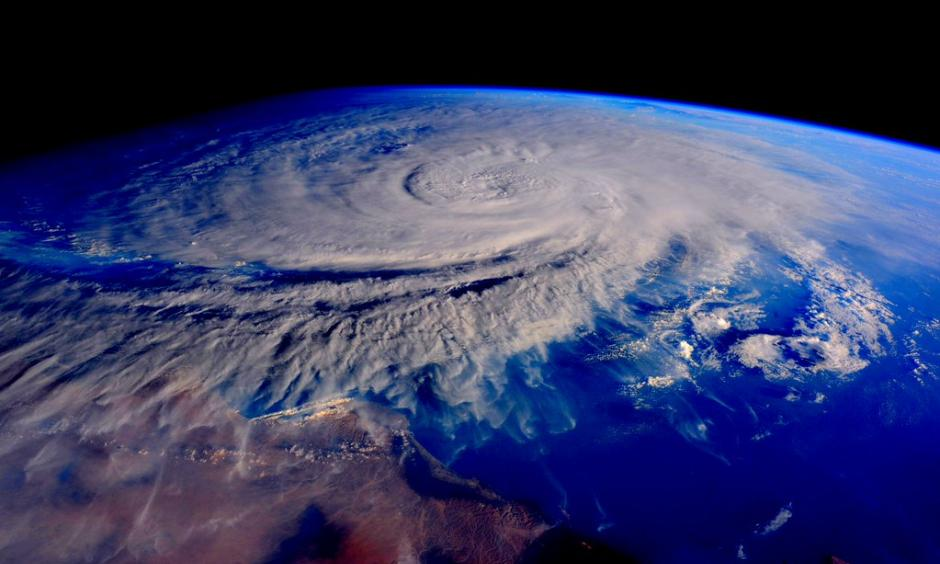 Tropical Cyclone Chapala as seen from the International Space Station at sunset on Halloween evening, October 31, 2015. At the time, Chapala was a Category 4 storm with 135 mph winds. The coast of Oman/Yemen is visible at the bottom of the image. Image: Commander Scott Kelly