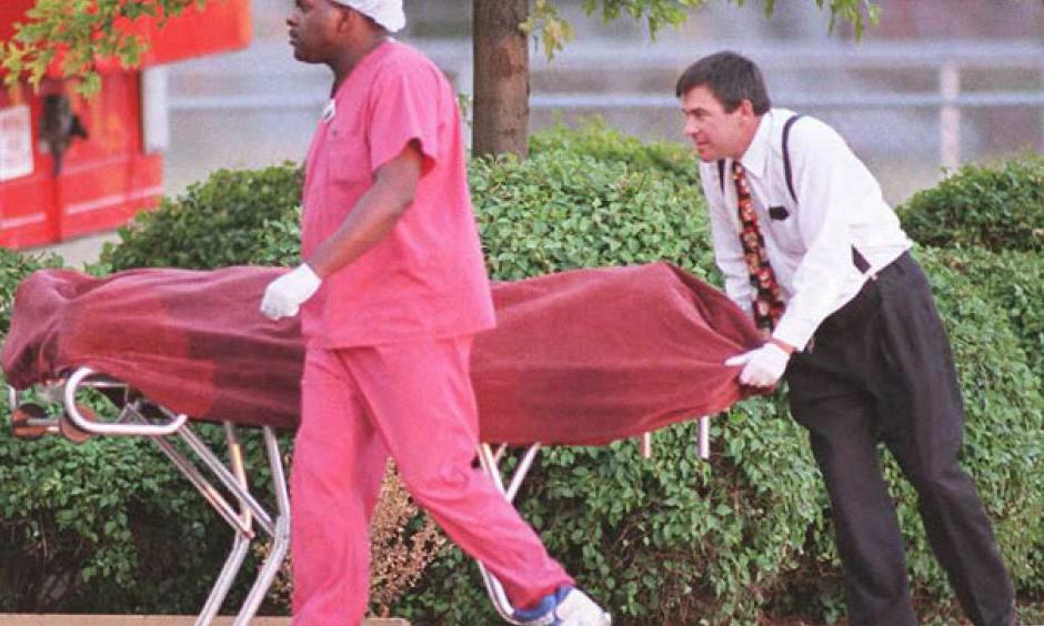 Medical examiners remove a body during the heat wave. Photo: Slate