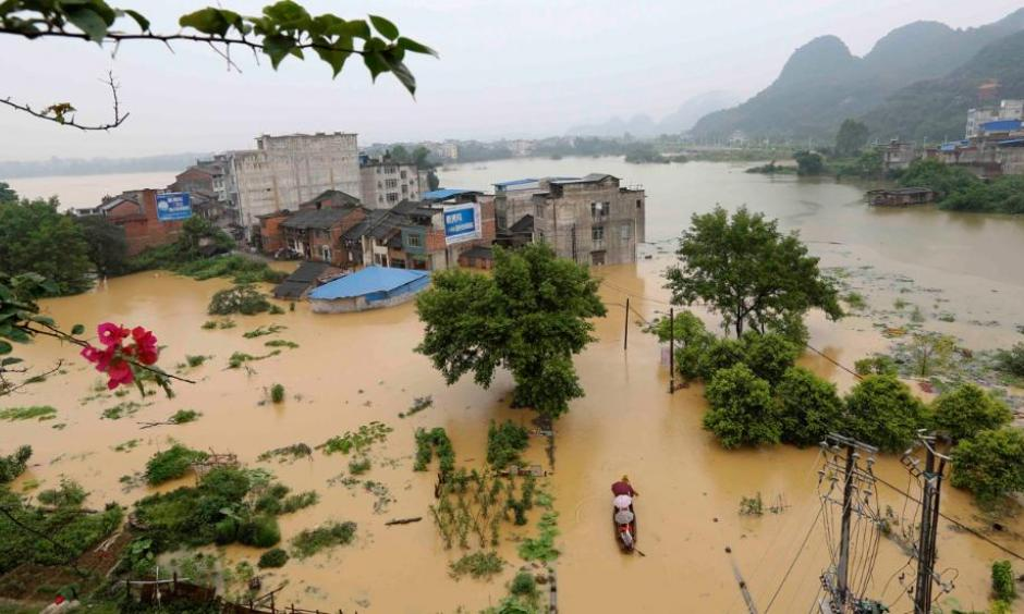 Aerial view of the flooded houses at Rongshui Miao Autonomous County on July 3, 2016 in Liuzhou, Guangxi Province of China. Photo: Long Tao/VCG via Getty Images