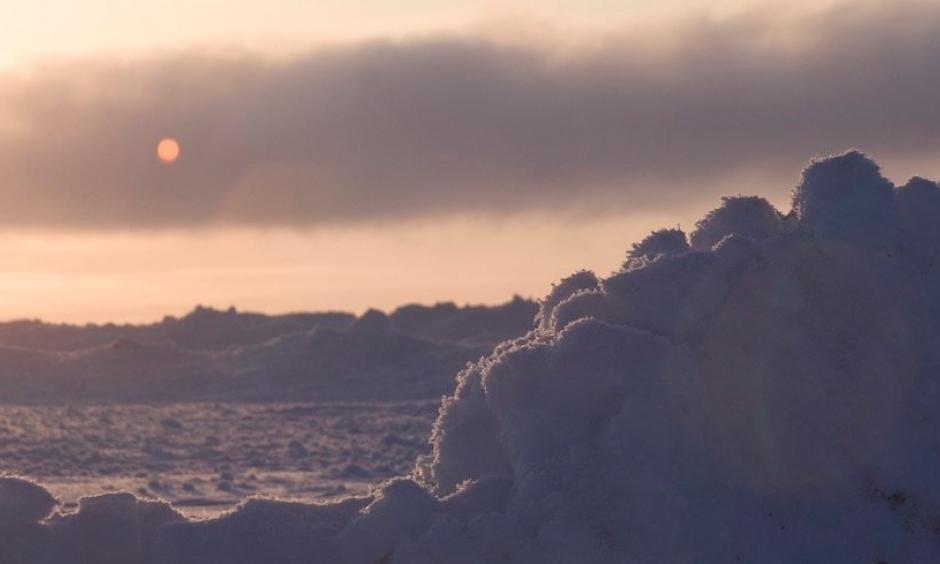 An early-spring sunset over the icy Chukchi Sea near Barrow (Utqiaġvik), Alaska, documented during the OASIS field project (Ocean_Atmosphere_Sea Ice_Snowpack) on March 22, 2009. Photo: Carlye Calvin, UCAR