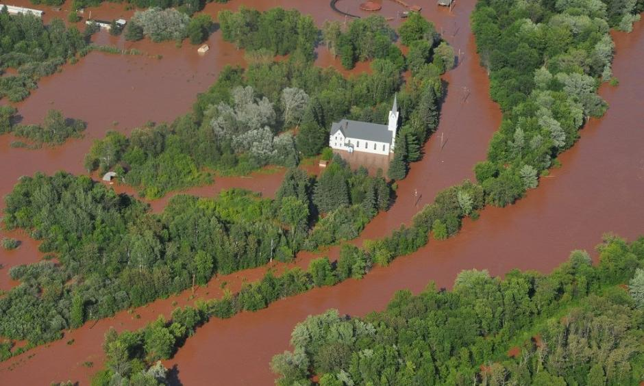 A church is surrounded by flood waters in the middle of the Bad River reservation in Odanah. Photo: Courtesy of the Bureau of Indian Affairs
