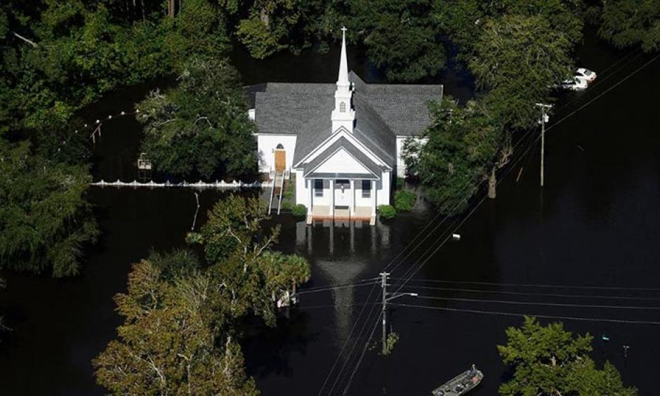 A boat passes a church in Nichols, S.C., Monday, Oct. 10, 2016. Photo: Rainier Ehrhardt, AP