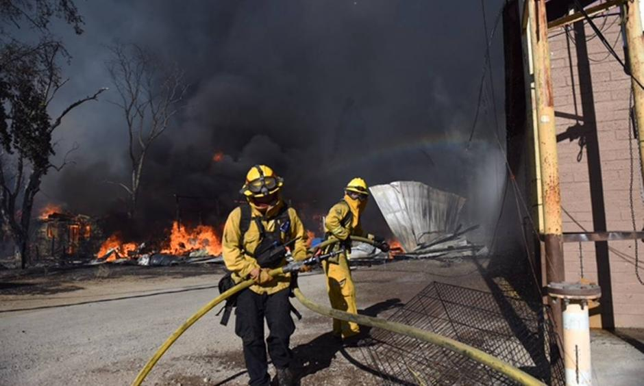 Firefighters battle Clayton Fire in the town of Lower Lake. Photo: Sacramento Bee