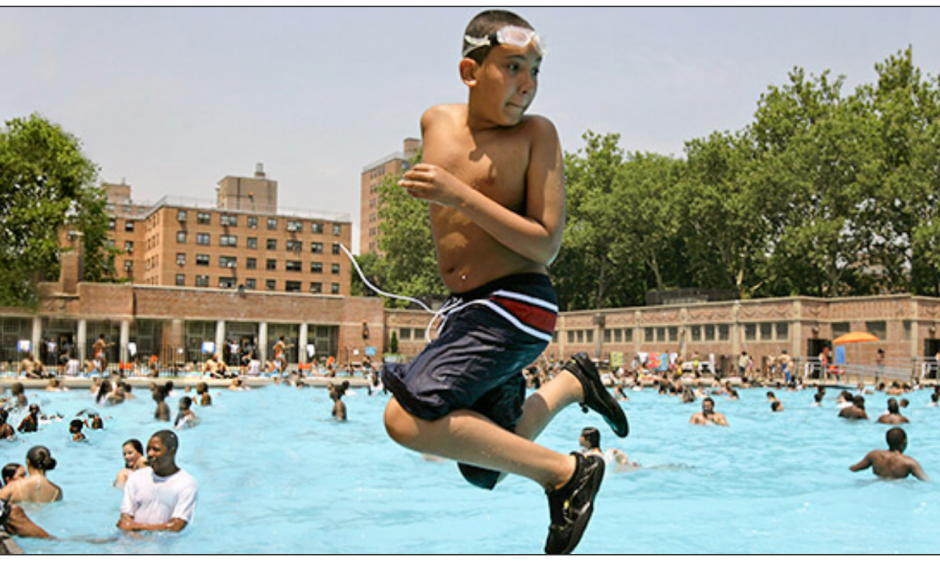 A youngster takes a backward plunge into the Thomas Jefferson pool in East Harlem in New York during a citywide heat wave in July. Photo: AP