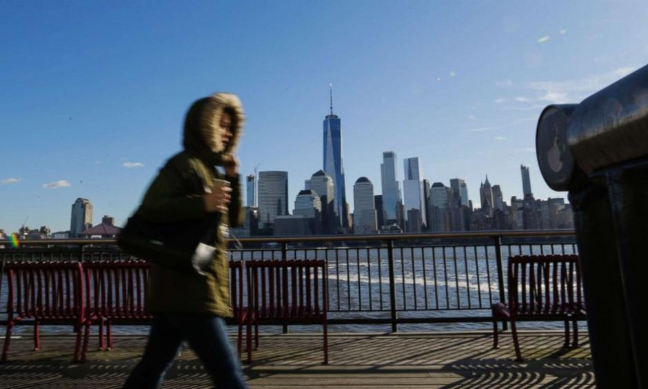 A commuter from New Jersey to New York, bundled up against the wind and the cold temperatures on November 10, 2017 in Exchange Place, Jersey City, N.J. The National Weather Service issued a freeze warning for the area. Photo: Getty Images