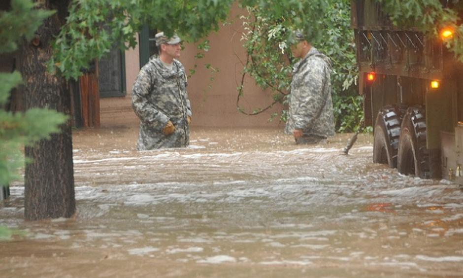 Two Colorado National Guardsmen waist deep in Boulder floodwaters. Photo: Colorado National Guard/Flickr