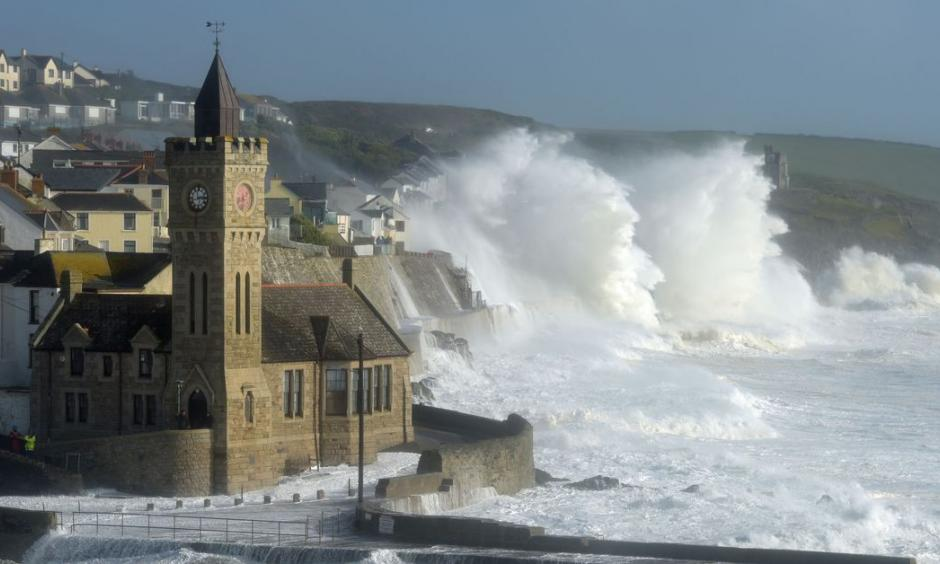 Waves break around the church in the harbor at Porthleven, Cornwall, as post-tropical cyclone Ophelia hits the UK and Ireland. Photo: Ben Birchall, PA Images