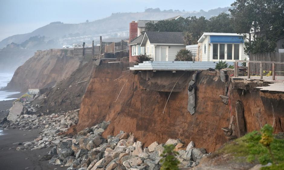 Sections of land are seen missing from coastal properties in Pacifica, California after El Niño-related storms on January 26, 2016. Photo: Josh Edelson, Getty Images