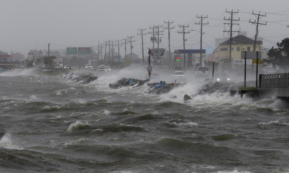 Water from Roanoke Sound pounds the Virginia Dare Trail in Manteo, N.C., Saturday, Sept. 3, 2016 as Tropical Storm Hermine passes the Outer Banks. Hermine lost hurricane strength over land but was intensifying Saturday along the Atlantic Coast, threatening heavy rain, wind and storm surges on its northward march. Photo: Tom Copeland, AP