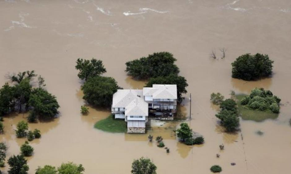 Flood waters from the Brazos River surround a home in Weatherford, Texas on Friday, May 29th. Photo: Brandon Wade, AP