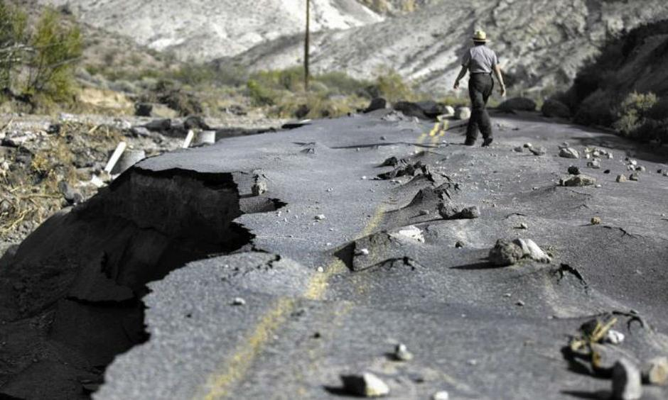 A 100-yard-long section of newly paved Highway 267 in Grapevine Canyon, a two-lane road designed to withstand severe flooding, was lifted up by roiling water and then slammed down on boulders in Death Valley National Park. (Brian van der Brug / Los Angeles Times)