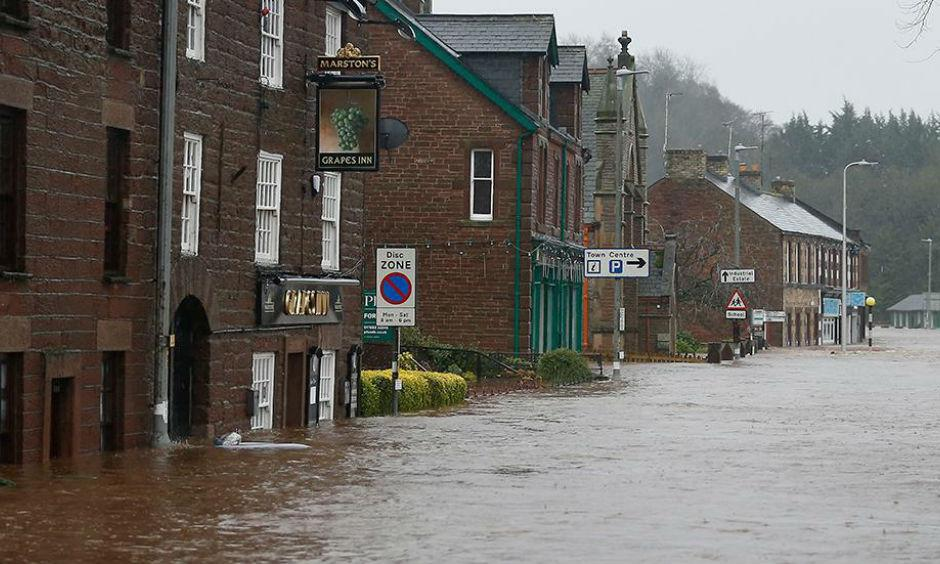 Flooded roads in the centre of Appleby, north west England, as Storm Desmond hits the United Kingdom, Saturday Dec. 5, 2015. Roads have been closed throughout the North and Scotland as Storm Desmond caused road chaos, landslides and flooding. Photo: Owen Humphreys/AP
