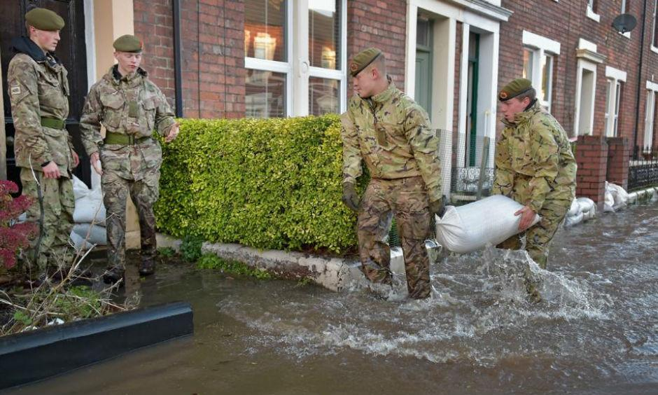 Members of the Army help with the rescue effort after Storm Desmond caused flooding on December 6, 2015 in Carlisle, England. Storm Desmond has brought severe disruption to areas of northern England as dozens of flood warnings remain in place. Photo: Jeff J Mitchell/Getty Images