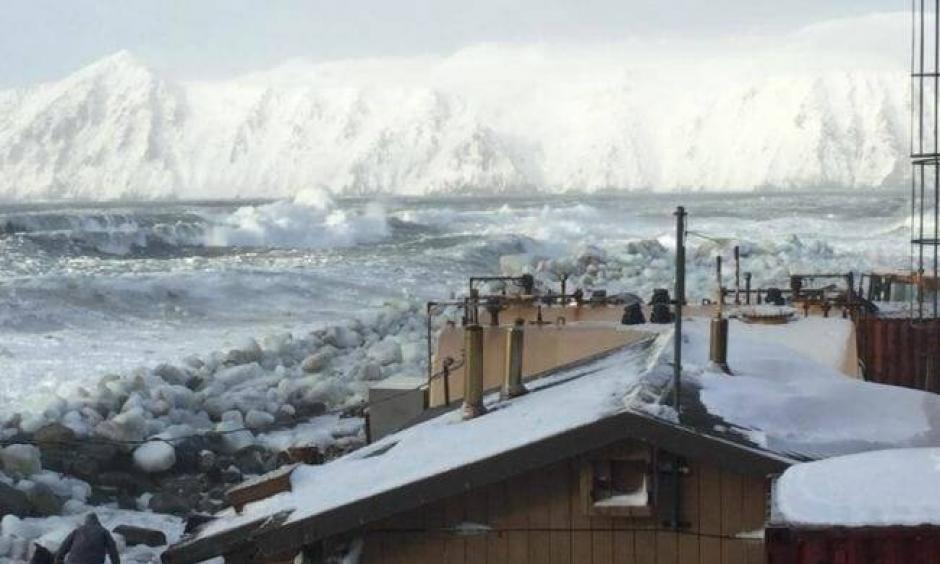 Waves batter Little Diomede Island, where the coastal community is normally protected by ice through the winter. This year was different. Photo: Frances Ozenna
