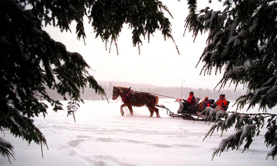 An iconic New England sleigh ride in Stowe, Vermont, in 1997. There may be fewer opportunities for rides like these in the future, thanks to climate change. Photo: Boston Globe