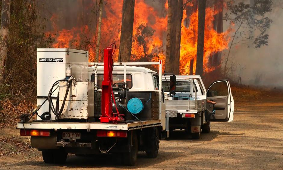 Firefighters battle bushfires in Busbys Flat, northern New South Wales, on 9 October. Photo: Jason O'Brien, AAP