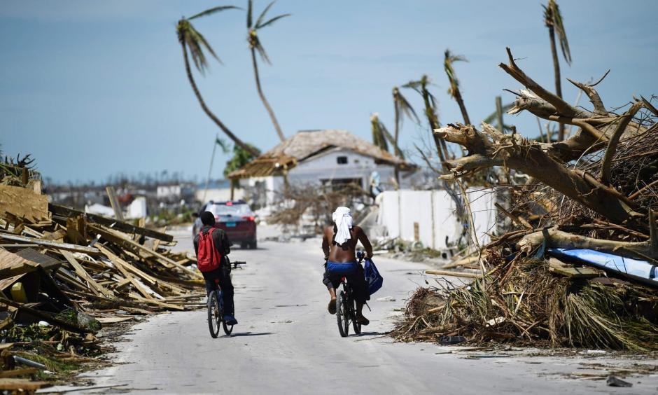 Residents pass damage caused by Hurricane Dorian in Marsh Harbour, Great Abaco Island in the Bahamas. Photo: Brendan Smialowski, AFP/Getty Images