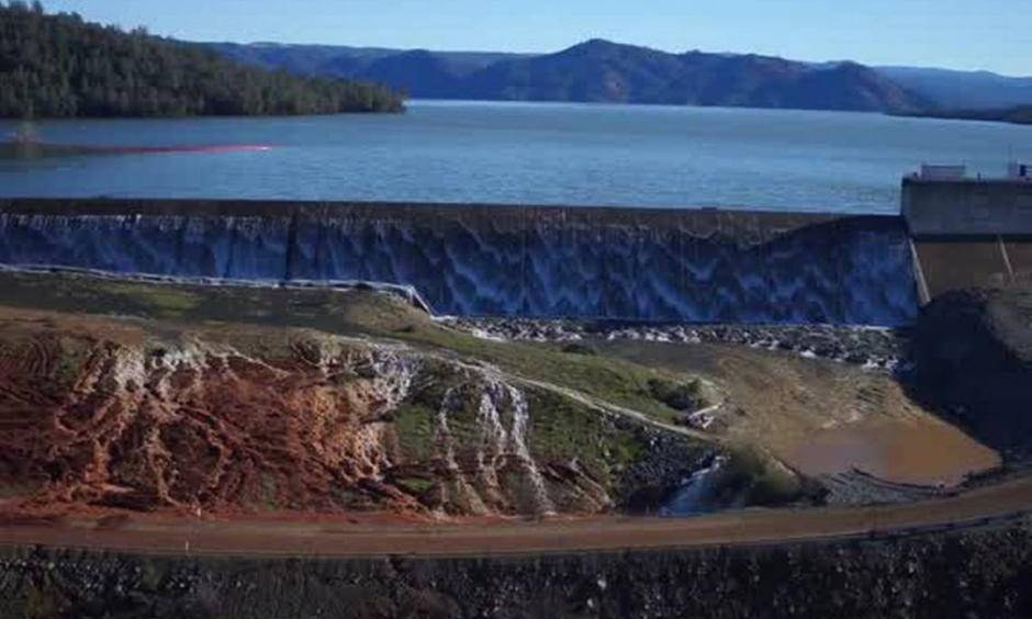 The Department of Water Resources released a video shot by a drone over the Oroville Dam. Water is seen running over the emergency spillway as well as the main spillway. Photo: Department of Water Resources