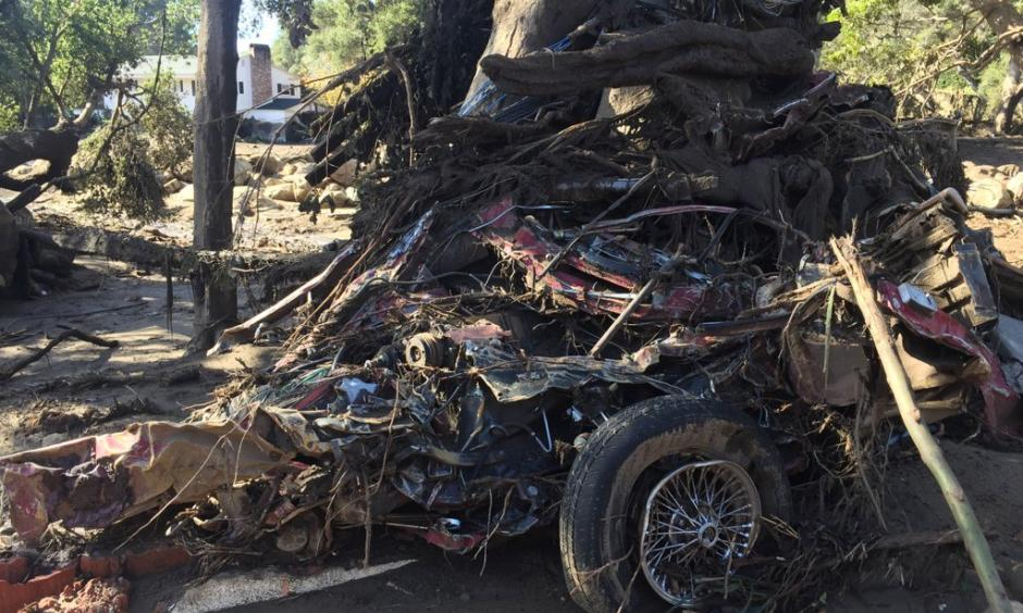 This crumbled car shows the force of the mudslide as debris roared through Montecito. Photo: James Cook via Twitter @BBCJAmesCool