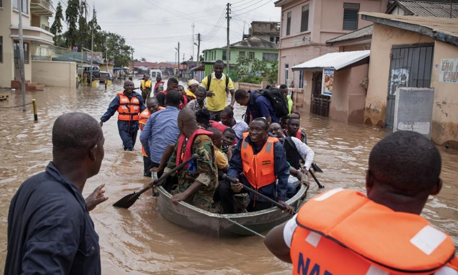 Rescue workers from Ghana's emergency services were called in to help as floods hit the capital city, Accra. Photo: Christian Thompson / EPA