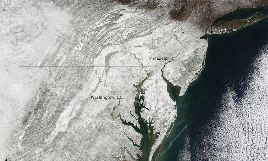 """Nicknamed """"snowpocalypse"""" and """"snowmageddon,"""" an exceptionally severe winter storm dropped several feet of snow around the Washington, D.C., area in early February 2010. Image: NASA"""