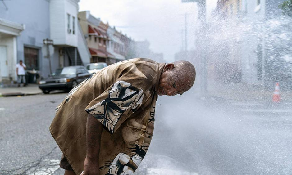 Eduardo Velev cools off in the spray of a fire hydrant in Philadelphia during a July 2018 heat wave. Scientists say last summer's extreme heat across the Northern Hemisphere wouldn't have happened without human-induced climate change. Photo: Jessica Kourkounis, Getty Images