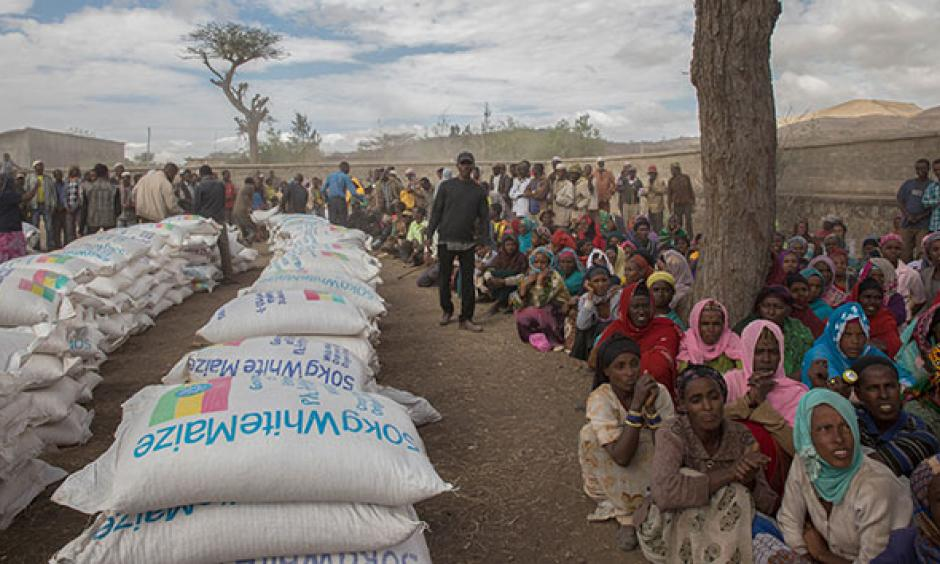 Ethiopians in the rural Ziway Dugda district await distribution of emergency food aid in January. Photo: Mulugeta Ayene, AP