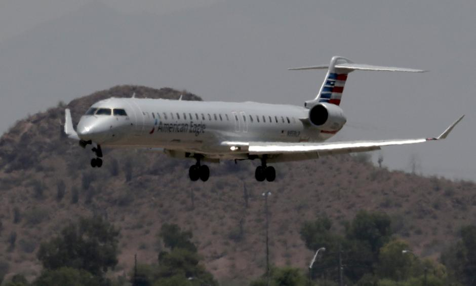 An American Eagle jet is seen through heat ripples as it lands at Sky Harbor International Airport, Monday, June 19, 2017 ,in Phoenix. American Airlines cancelled dozens flights out of Phoenix today due to extreme heat. The cancellations are for operations by smaller regional jets that have lower maximum operating temperatures than full size jets. The smaller jets can't operate when it's 118 degrees or higher. Photo: Matt York, Associated Press