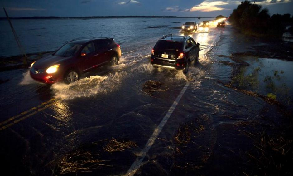A perigean spring tide floods Highway 80, the only road to Tybee Island, Ga., June 4, 2016. Photo: Stephen B. Morton/The New York Times