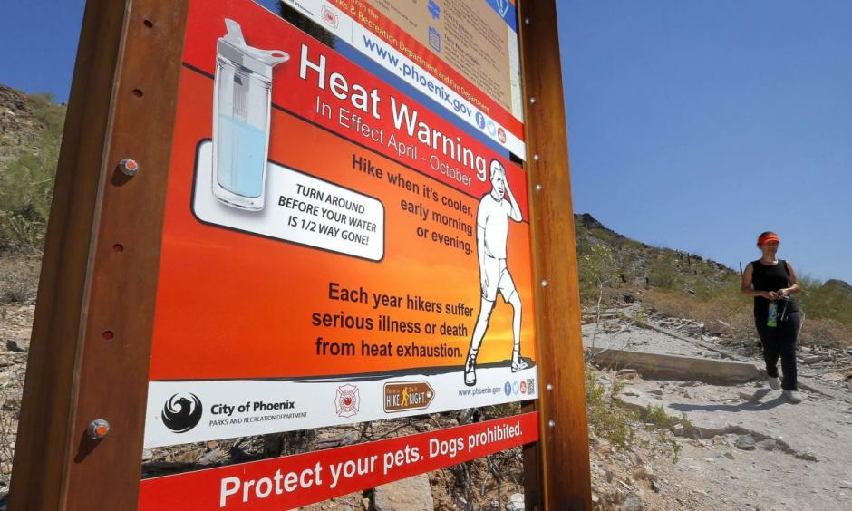 In this June 22, 2016 file photo, a sign warning of extreme heat is seen on a trailhead at Piestewa Peak in Phoenix. Thirty-one of the country's top science organizations are telling Congress that global warming is real, a problem and something needs to be done about it. The science groups, which represent millions of scientists, sent the letter Tuesday, June 28, 2016, saying the severity of climate change is increasing and will get worse faster in coming decades. Photo: Matt York, AP
